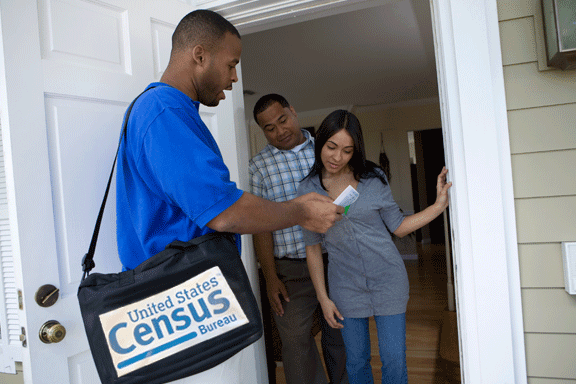 Census worker interviews residents
