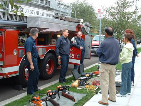 Fire Services staff showing citizens fire equipment